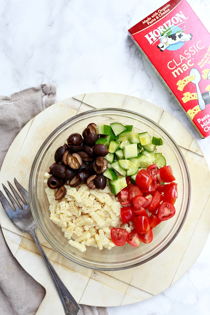 Pasta salad recipe for kids with cucumber, tomato, and olives