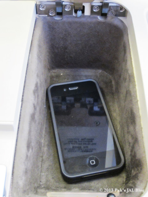 iPhone 4 in the small storage compartment.
