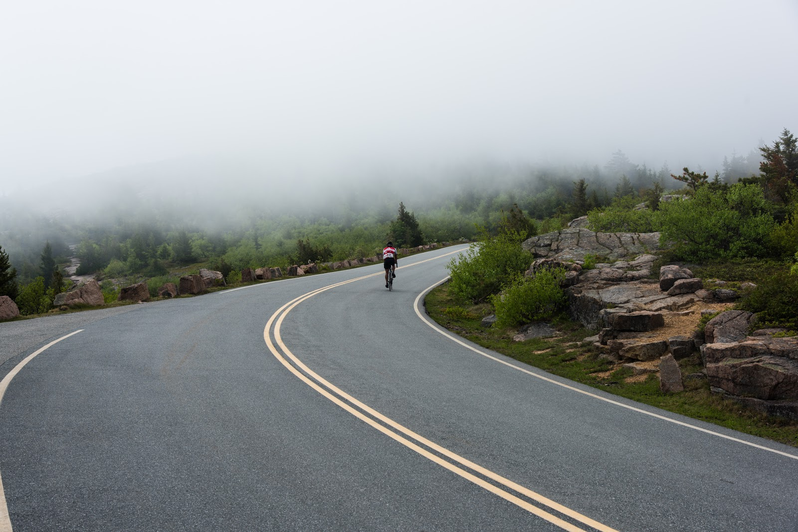 A Cyclist Ascends into the Clouds Near the Peak of Cadillac Mountain (Image ©2015 Ben Sullivan)