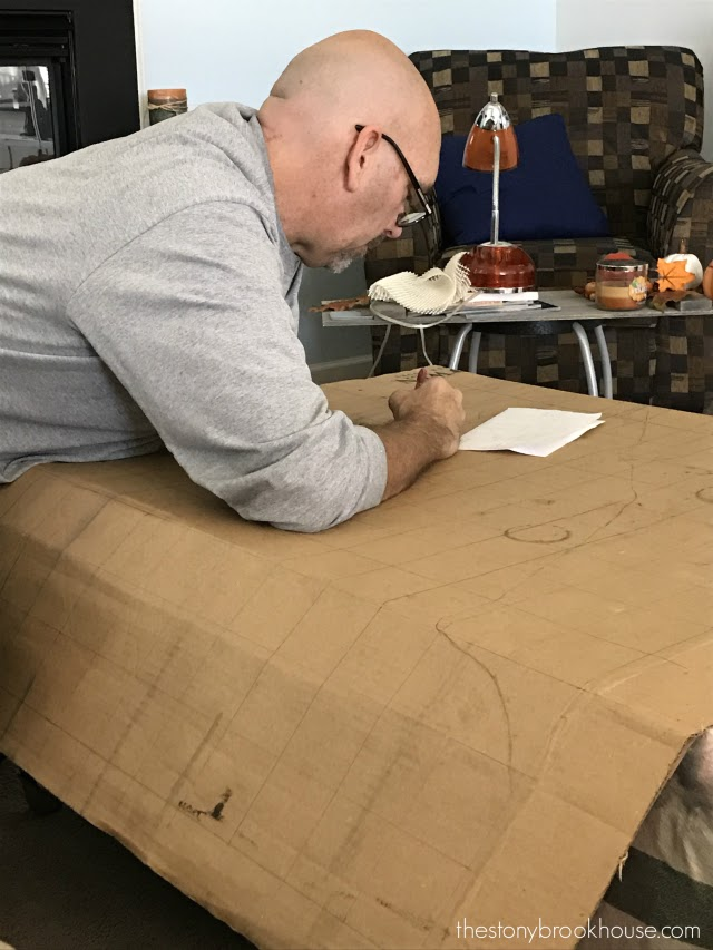 Drawing nativity pattern on to cardboard