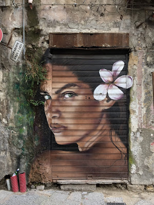 Palermo street art: exotic face