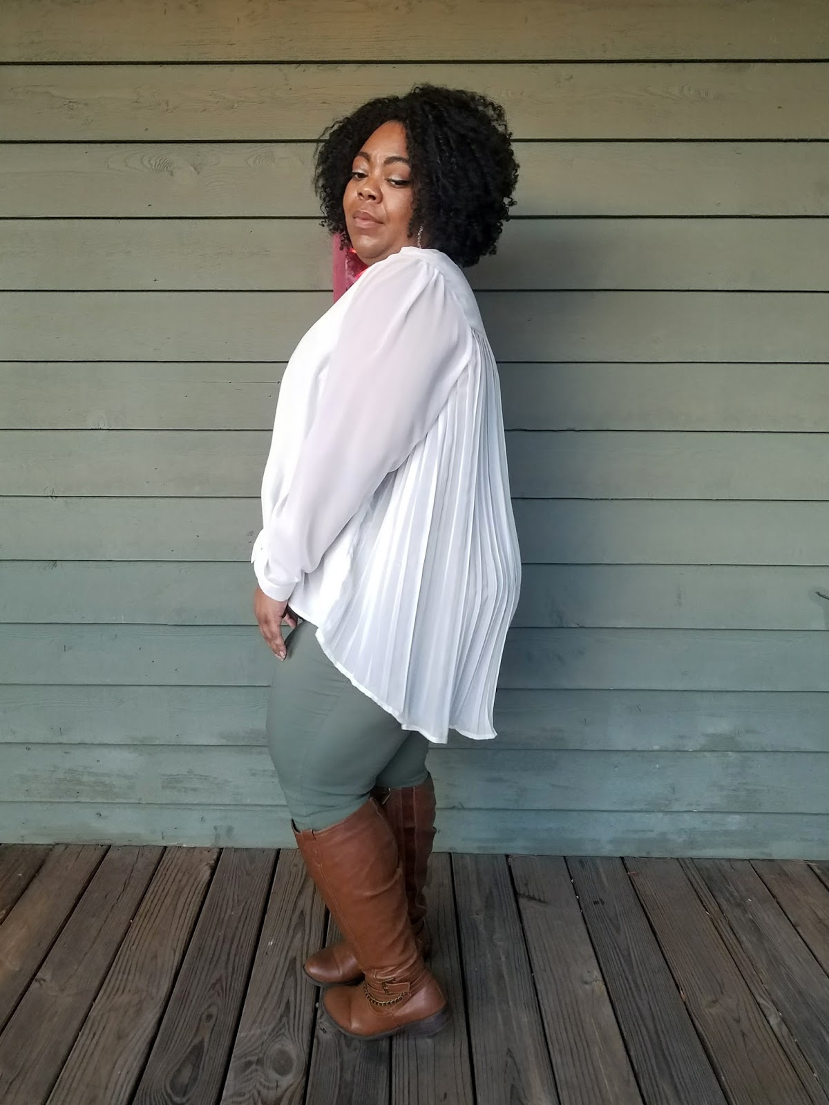 plus size, curvy model, flowy blouse, tall boots, jeggings, kinky natural hair