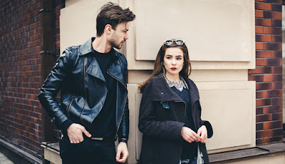 20 Revealing Signs That Show You May Be Growing Apart man woman wear black jackets couple