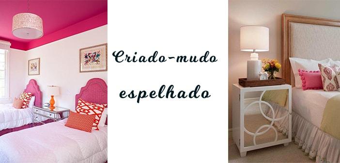 quarto rosa para duas moças e criado-mudo espelhado