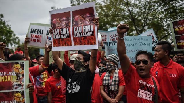 Malasios exigen cierre de medios locales financiados por EEUU