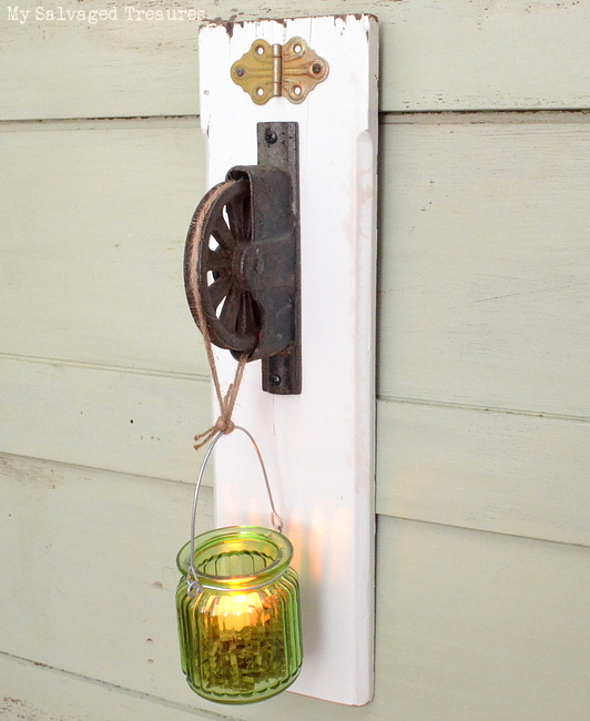 how to turn an old pulley and a piece of scrap wood into a tea light holder