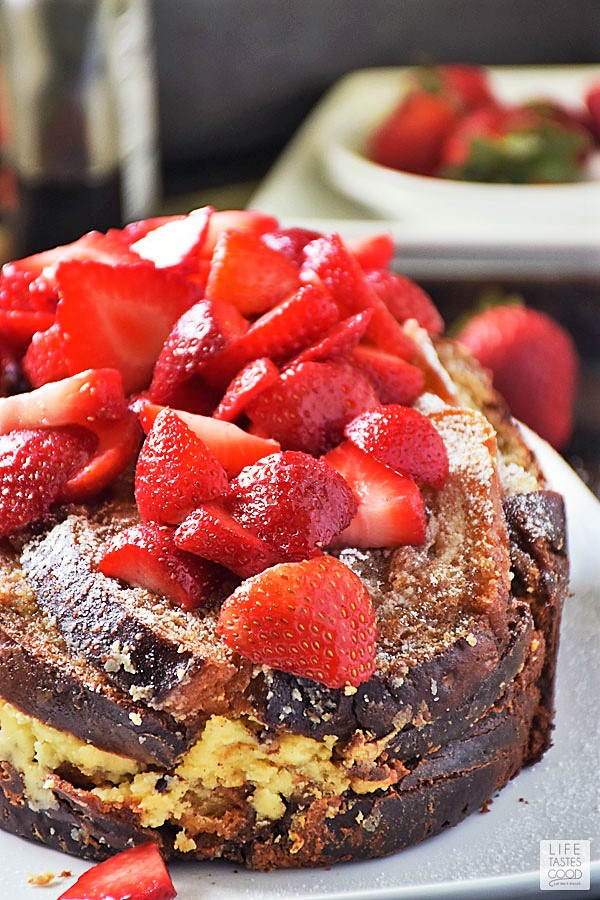 Stuffed French Toast on a white tray topped with strawberries