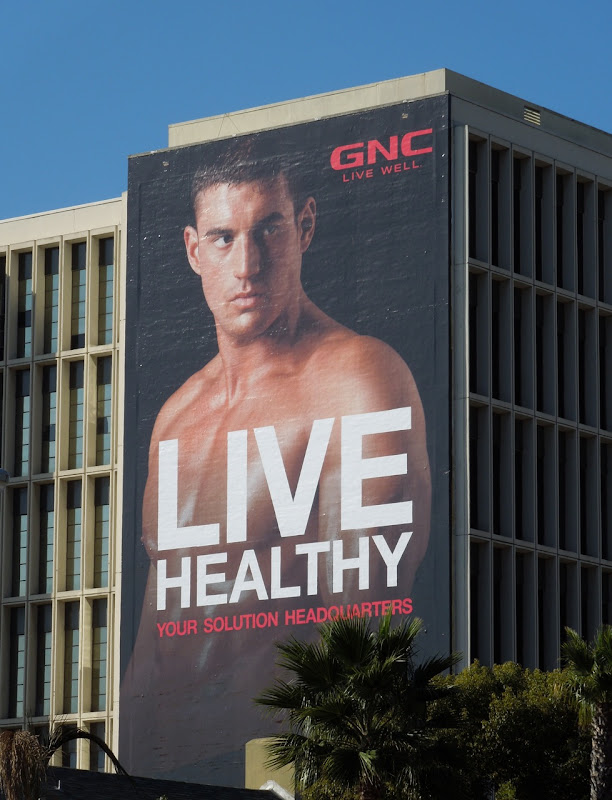 GNC Healthy male model billboard