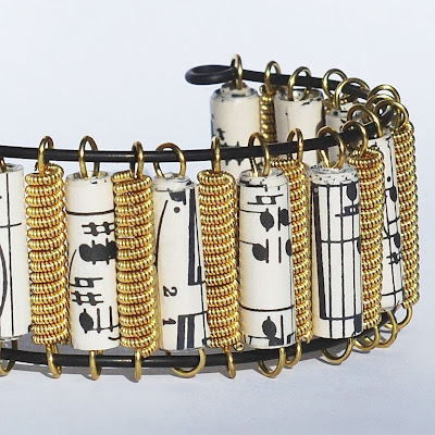 guitar string jewelry by tanith rohe guitar string bracelet brass sheet music paper bead cuff. Black Bedroom Furniture Sets. Home Design Ideas