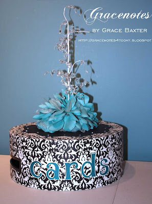 Wedding Card Box, black and white with aqua'teal embellishments and a fountain of crystals. Designed by Grace Baxter.