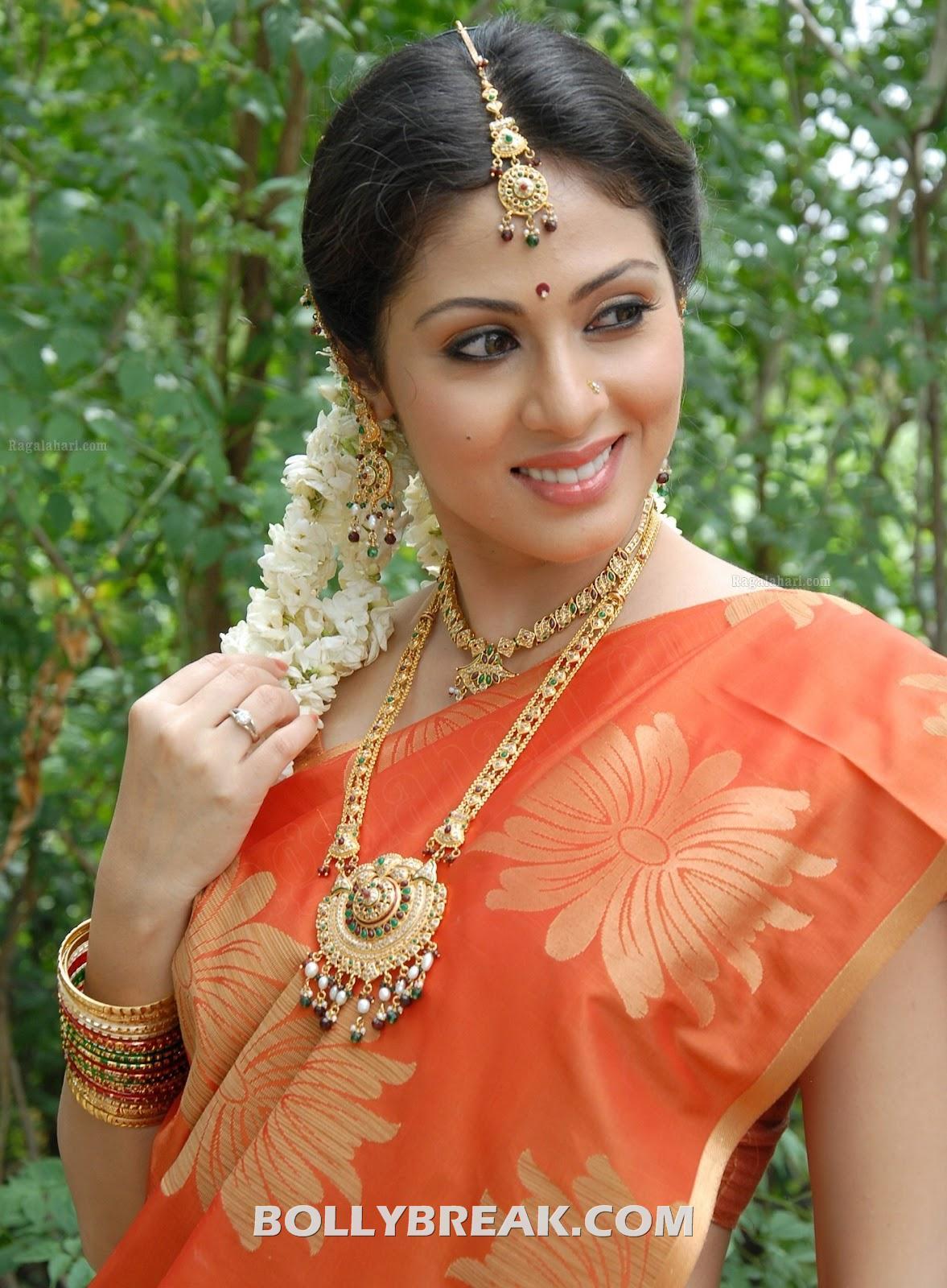 Sada In Orange Saree Photos