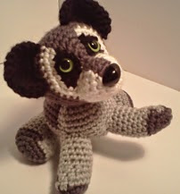 http://www.ravelry.com/patterns/library/benjamin-baby-raccoon-amipal-amigurumi-stuffed-animal-pattern