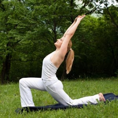 Woman doing yoga exercise in nature
