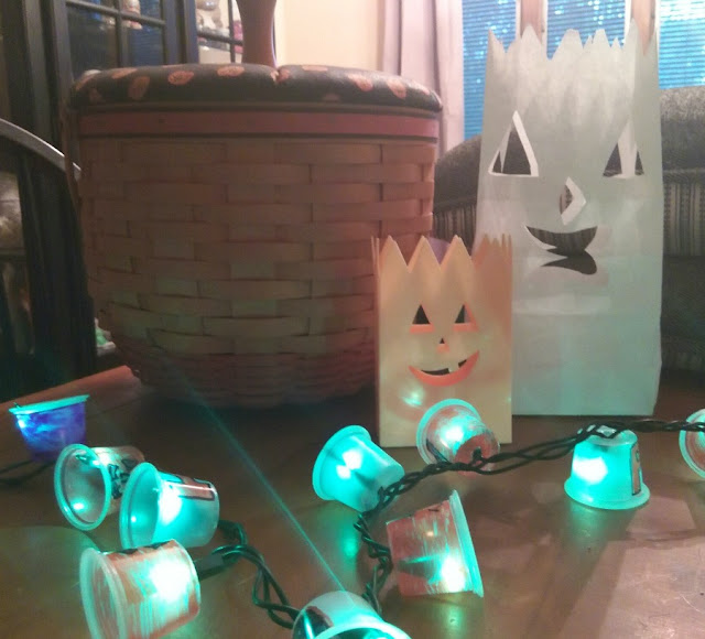 Make your own homemade holiday light covers for Halloween.