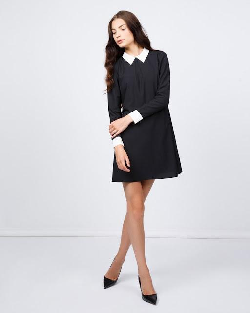 abito nero con colletto bianco