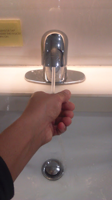 JustMom-faucet-hands-near-with-water