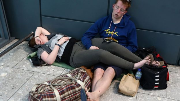 PHOTOS: Passengers stranded at airport terminals