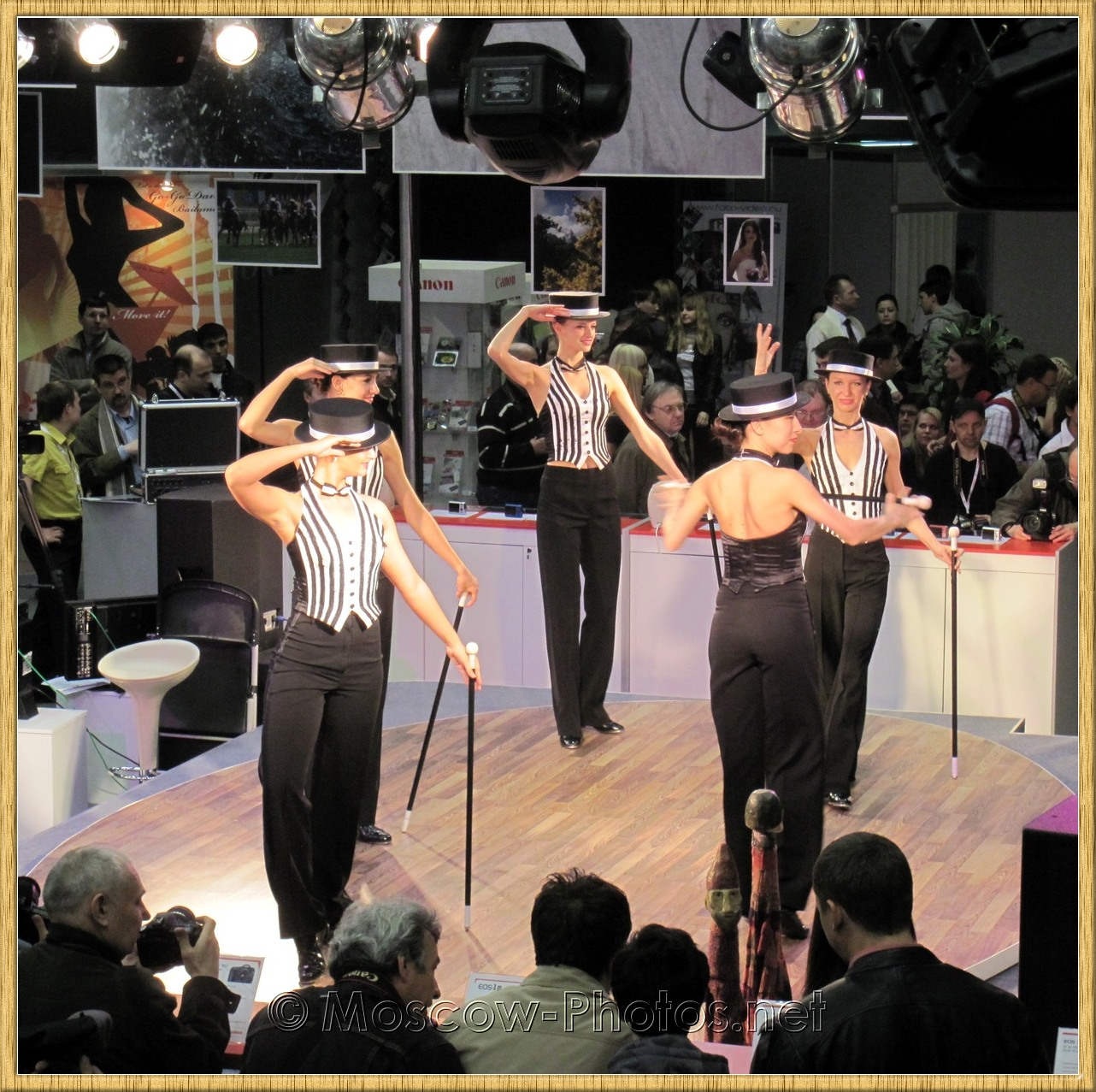 Dancing girls with hats and canes