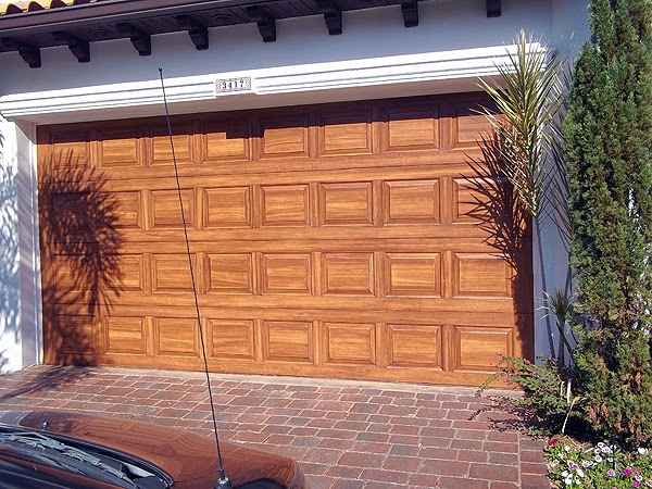 Garage door painting project finished everything i for Paint garage door to look like wood
