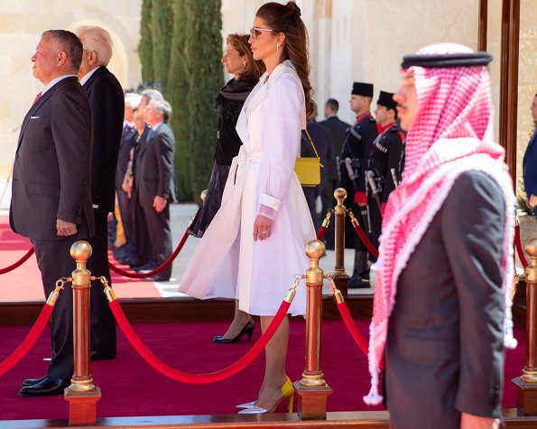 Queen Rania wore a long trench coat by Lanvin. Queen Rania wore Lanvin lacquered twill and organza long trench coat