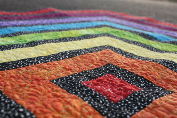 Rainbow Ripple Quilt | DevotedQuilter.blogspot.com