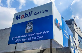 Exxon mobil presents mobile car care and mobile bike care workshop