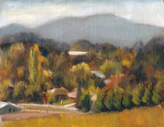 Oil painting of a township surrounded by trees with a mountain range in the distance.