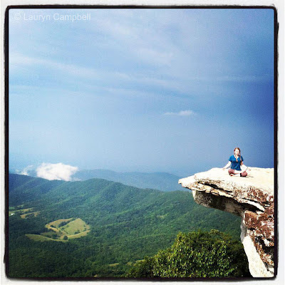 "Lauryn ""Slaughterhouse"" Campbell meditating on a rocky cliff while on The Appalachian Trail"