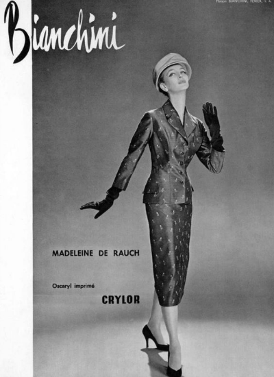 Model Dorian Leigh posing in Madeleine de Rauch Suit for Guy Arsac 1956 photo