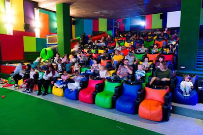 Inside Ster-Kinekor Kids' Cinema with seats and slide into ball pit