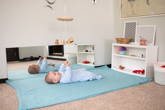 A movement area for a Montessori baby that can move! As a baby starts to roll, some changes need to be made to accommodate play and exploration.