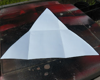 Folding and cutting an equilateral triangle
