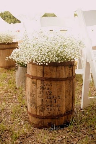 baby's breath in vintage wine barrels