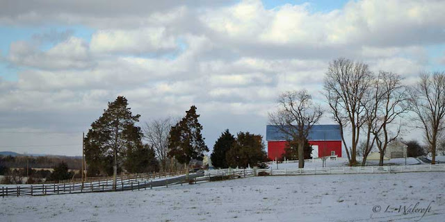 snow scene with red barn