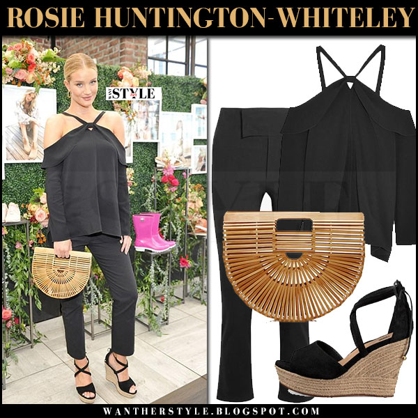Rosie Huntington-Whiteley in black off shoulder top, black pants, black ugg reagan wedge sandals with bamboo bag cult gaia what she wore march 2017