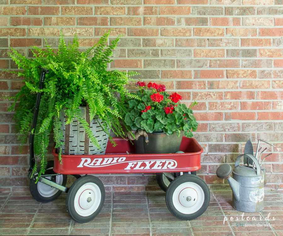 vintage radio flyer red wagon with summer flowers