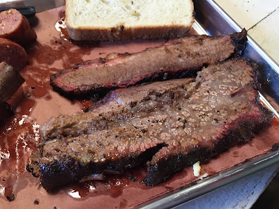 A close up on Truth Barbecue's cuts of brisket