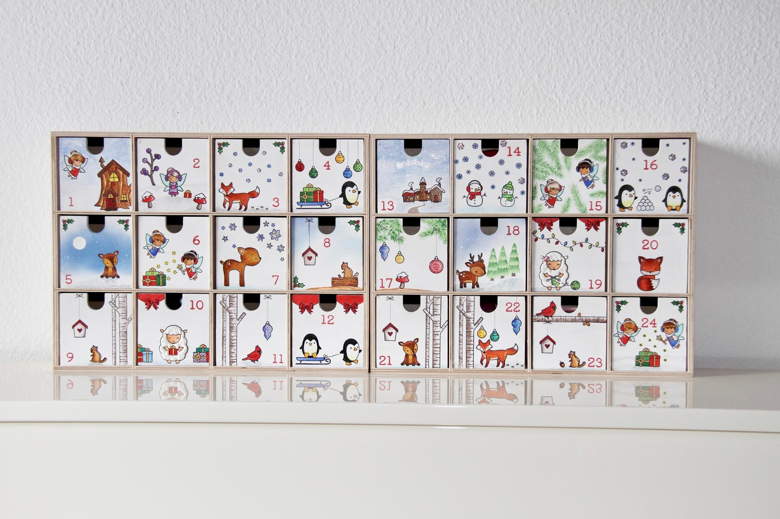advent calendar with moppe shelf drawers by ikea papierlisi. Black Bedroom Furniture Sets. Home Design Ideas