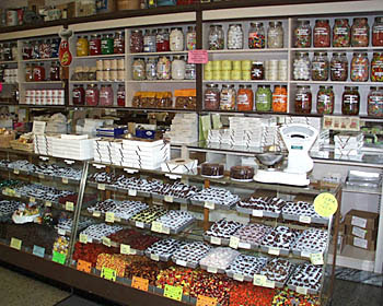 schimphs candy store full of jars and display cases of different candies for sale