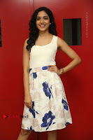 Actress Ritu Varma Stills in White Floral Short Dress at Kesava Movie Success Meet .COM 0149.JPG