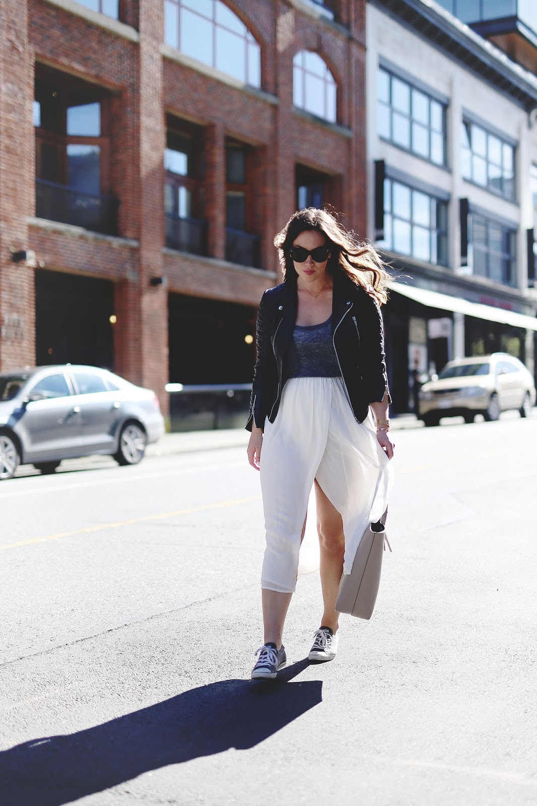 to vogue or bust, vancouver style blog, vancouver fashion blog, vancouver lifestyle blog, vancouver travel blog, vancouver fitness blog, vancouver health blog, canadian fashion blog, canadian style blog, canadian lifestyle blog, canadian travel blog, canadian fitness blog, canadian health blog, popular fashion blog, popular style blog, popular travel blog, best fashion blogs, best style blogs, best travel blogs, best fitness blogs, best health blogs, best lifestyle blogs, top travel blogs, top style blogs, top fashion blogs, top fitness blogs, top health blogs, alexandra grant, aritzia silk skirt, walter baker leather jacket, celine caty sunglasses, z supply tank top, converse sneakers, how to style converse sneakers, how to wear converse sneakers and a skirt together, how to wear leather jacket and skirt together, how to pose for pictures, how to take walking pictures, how to pose like a blogger, how to take good pictures, how to be photogenic, how to pose for a photoshoot, how to pose for pictures like a model, how to smile for pictures