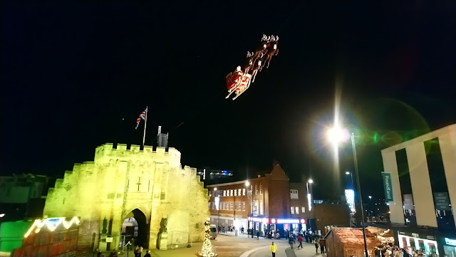 Santa flying from The Bargate