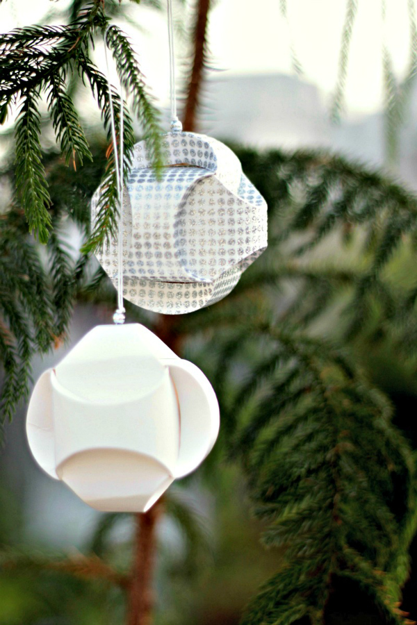 two handmade sculptural paper ornaments