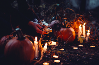 picture of pumpkins, candles, and a woman's hands