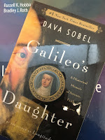 Galileo's Daughter, by Dava Sobel, superimposed on Intermediate Physics for Medicine and Biology.