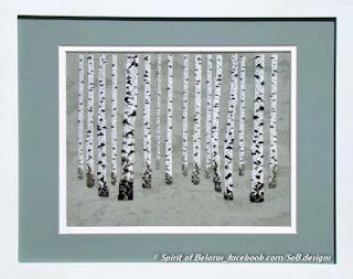 embroidered picture of white and black barked birch tree trunks in a stand of birch trees