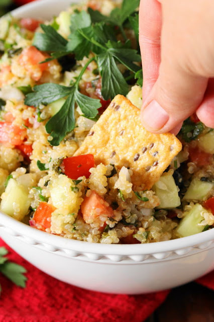 Enjoy this Quinoa Tabouli with crackers or pita for a totally tasty and satisfying side dish or snack.  Loaded with great flavor from fresh vegetables and herbs, it's a perfect pick for healthier snacking!
