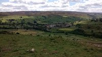 view of a farmhouse swaledale valley mountain biking the Yorkshire dales- by: © Paul c Walton