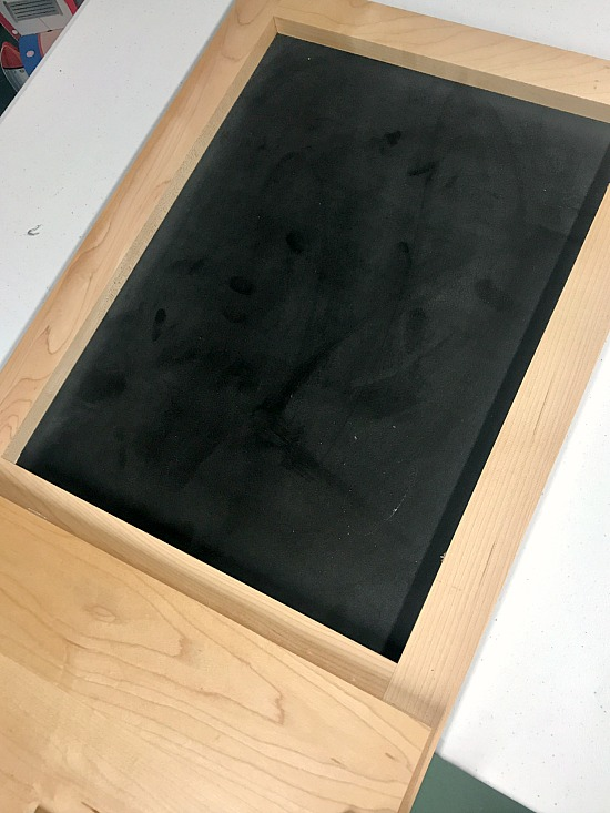 Adding pre-made chalkboard to a repurposed cabinet