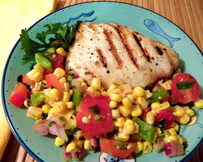Grilled Halibut Plated with Generous Portion of Corn and Tomato Salad